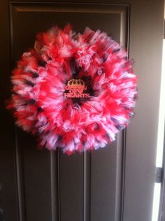 This is a red, white and black tule wreath inspired by the queen of hearts.