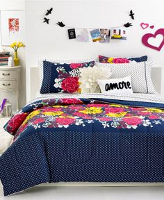 Seventeen Chloe Garden Comforter Sets Floral frenzy. An artistic flower design in bright yellow, pink and purple colors enhances a deep navy background in these Chloe Garden comforter sets from Seventeen. Whimsical polka dots finish the look. Get it here: http://www1.macys.com/shop/product/seventeen-chloe-garden-comforter-sets?ID=1020808&CategoryID=26795#fn=sp%3D1%26spc%3D4%26kws%3Dseventeen%26slotId%3D1