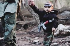 An anguished mother says a terror tyke seen in ISIS propaganda sporting a black headband and a tiny AK-47 is her son – and she's pleading for help in getting the 3-year-old back from the terror group. <=  I'd like to read or write a realist book about this sort of situation. This tragedy feels so far away, I think we needs some books to make us realize how close at hand it really is, like Charles Dickens did in his time.