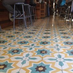 Patterned tile - maybe we can stencil the kitchen tiles?