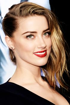 Amber Heard's hair pulled tight on one side: http://beautyeditor.ca/2014/02/14/fake-an-undercut/