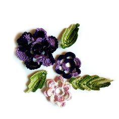Crochet cute flowers. Found here: http://www.etsy.com/treasury/Njg1Mjc5NnwyNzIzMjQxNzg2/so-many-choices or http://www.etsy.com/listing/101337835/hand-crochet-set-of-melange-purple-and?ref=tre-2723241786-11 #681team