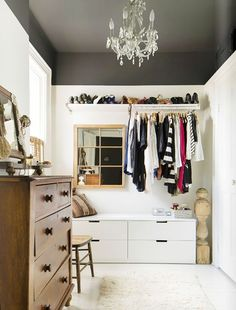 The ceiling of this divinely organized closet makes the compact spaceall the more artful and inviting. The steely charcoal shade adds a flourish of masculine edge. Looking for some color...