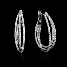 This stylish pair of white gold hoop earrings, feature 276 round brilliant cut white diamonds of F color, clarity and excellent cut and brilliance, weighing carats total. Emerald Earrings, Sterling Silver Earrings Studs, Silver Hoop Earrings, Crystal Earrings, Women's Earrings, Diamond Hoop Earrings, Rose Necklace, Black Earrings, Silver Ring