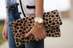 Check out The Providence Story's version of this clutch!  https://www.etsy.com/listing/157372286/cheetah-print-calf-hair-fold-over-clutch?ref=shop_home_active