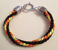 Black, yellow and orange Kumihimo bracelet by Jewellery by Janine https://www.facebook.com/JewelleryByJanine