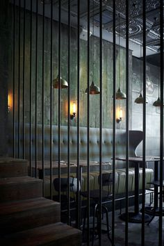 Pure Creative's relaxing dining room with industrial materials, metal tin ceilings, dark hand-sketched graphics on black walls create a fun and playful environment. Serving up traditional Italian in Shanghai.