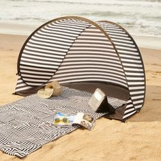 Get sun-kissed in style with this chic striped beach tent from Kate Spade!