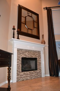 Definitely going to glass tile the gas fireplace...similar to this but more grey/green color in the tiles.  Great room is khaki/green paint, eat-in kitchen is darker olive green and kitchen is olive-based grey (all open).