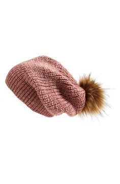 #Nordstrom.  #FreePeople. Pompom Beanie.  Item #1164784.  $58.  Rosewood (pictured), Charcoal, and Oatmeal.