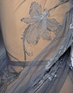 Dior... NOT embroidered by Galliano,indefinitely NOT...:)...and it is NOT even because of his anticemitism or alco/narcomania...;) ........ howerver ....Wonderfully delicat work,isn´t it?.....there we go :)
