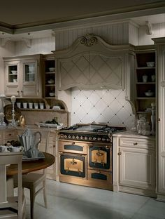 kitchen with dual gas and electric range cooker. decorative range hood cover.