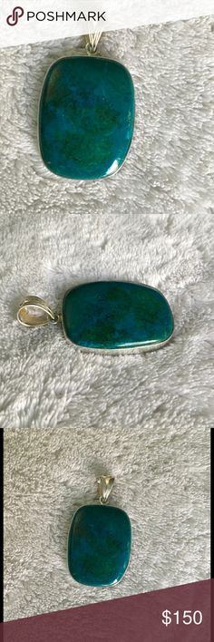 Chrysocolla Pendant (B) in .925 silver Beautiful rectangular larger/flatter shaped chrysocolla stone Pendant in .925 silver.  Pretty design on bail. Stone Information - Chrysocolla is a gemstone quality hydrous copper silicate, often forming with copper salts, iron and manganese oxides.  Chemical formula - Cu2H2Si2O5(OH)4.   Azurite, malachite and chrysocolla are commonly found in the oxidized zones of copper veins and deposits. The color is usually green to sky blue and is idiochromatic due…
