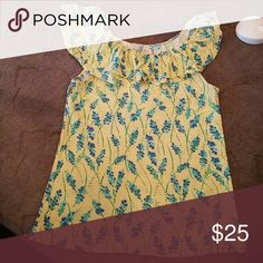 Lilly Pulitzer wynne top size large Beautiful yellow too with blue and green floral design. This top was washed but never worn. Lilly Pulitzer Tops Tees - Short Sleeve