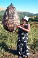 Mary Sibaya holding a large Wedding Basket, copywrite Tribal Home