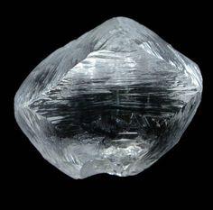 Uncut Rough Diamond Crystal (4.85 carat cuttable F-color octahedral crystal) from Udachnaya Mine, Republic of Sakha, Siberia, Russia.