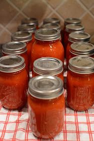 Canned tomato sauce with basil and garlic. Want to try this summer... Try using Roma tomatoes and do not process like juice, just blend them up!