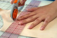 Picture of how to cut leather/use rotary cutter instead of scissors.