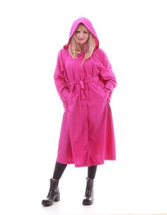 This rich and vibrant magenta pink nylon coat is long and lightweight, perfect for layering. Front pockets, matching tie belt, button front closure,