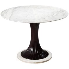 Osvaldo Borsani Round Marble Pedestal Table  | See more antique and modern Dining Room Tables at https://www.1stdibs.com/furniture/tables/dining-room-tables