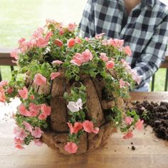 This easy DIY will show you how to plant flowers in a sphere-shaped hanging basket. Now you don't need to wait for you flowers to grow and cover your hanging basket. In no time, your plants will grow into a stunning ball of color. Hanging Plants Outdoor, Plants For Hanging Baskets, Patio Plants, Container Plants, Container Gardening, Container Flowers, Flower Planters, Tree Planters, Hanging Flower Pots