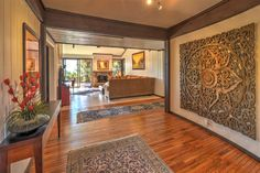 Staged to sell this one of a kind zen style home that will take your breath away. The entry way, with wonderful hardwood floors, opens into a stylish living room with views of the city lights and lush green landscaping. The tropical backyard will allow you to enjoy your own private jacuzzi or fire pit.