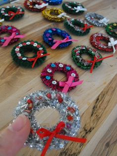 Mini wreaths made with cardboard rings, pipe cleaners, and all kinds of sparkle....