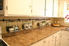 Unclutter you kitchen counter! Great idea! I could wipe it off without moving everything!!