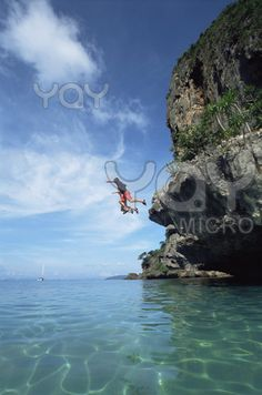 Cliff diving into beautiful ocean  Ohhh my goodness wouldn't that be an adrenaline rush for someone who is afraid of heights.