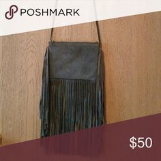 Suede Leather Crossbody Purse Dark grey boho fringe purse from top shop. Never used. Just big enough for a larger wallet to fit inside. Topshop Bags Crossbody Bags