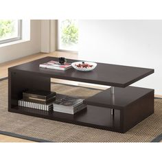 Prop your feet up or give stray magazines a home with this modern coffee table from Baxton Studio. This stunning piece is made from faux wood and steel, and the dark brown finish is elegant and classy. The unique design makes storage a breeze.