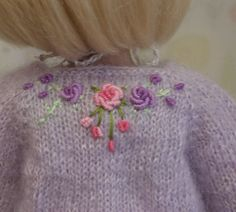 A Bouquet For You:  embroidery on the back of the sweater shows bullion stitch embroidered flowers and roses.