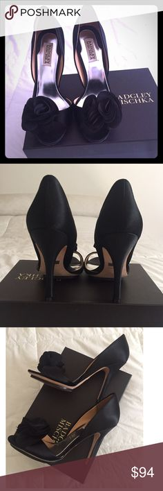 "BADGLEY MISCHKA Evenind shoe👠 Black Randall open toe satin heel and leather sole. Features beautiful silk flowers on the tips of the shoe. Heel approximately 4.5"" extra set of nibs and original box included. Wore them once for an indoor wedding.  *Like new, no visible signs of damage Badgley Mischka Shoes Heels"