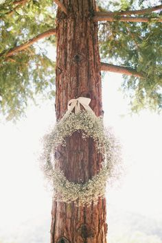 Baby's breath wreath: http://www.stylemepretty.com/little-black-book-blog/2014/11/07/south-african-winemaker-marries-in-napa/ | Photography: onelove - http://www.onelove-photo.com/