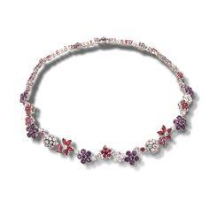 Van Cleef & Arpels - Folie des Prés necklace.. A stunning floral theme platinum necklace filled with diamonds, rubies and amethyst....