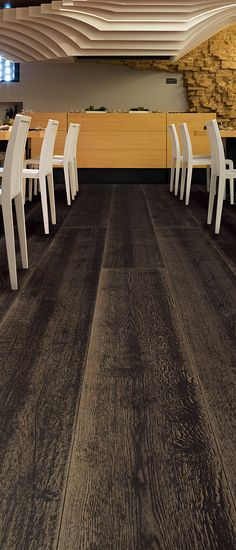 Lindura is a new kind of wood composite flooring that combines modern technology with the look and durability of traditional wood from Skema. Shown here in Black Way.