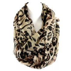 "B128 Brown Metallic Glitter Leopard Infinity Scarf Animal Print Infinity Scarf  This is a very thick, soft and luxurious scarf.  You will never want to take it off.  Sure to dress up even the most basic outfit!  Gold metallic highlights throughout.   Very wide.  100% polyester.   39"" wide, 40"" long.  Please check my closet for more items including jewelry and designer clothing!       B128 Boutique Accessories Scarves & Wraps"