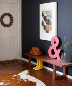 I love everything about this living room: ampersand art, cow hide rug, modern chairs