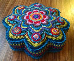 """have this pattern, but this has more ornate additives to """"petals"""" that the small flowers on others I've made"""