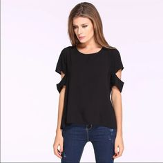 Women's blouse Dress it up or dress it down! This blouse features cut out sleeves and a open back. Pair is with high waisted jeans for a sexy look Obsessed Boutique Tops Blouses