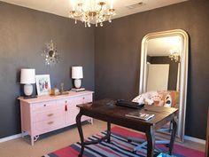 Dark gray office, vintage chandelier, pink bamboo dresser