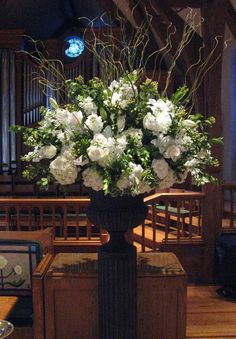 white hydrangeas, casablanca lilies, white stock and curly willow in pedestal urn