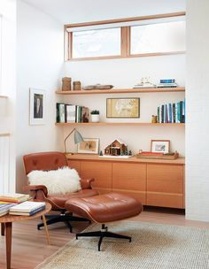 This area of the living room, with its built-in cabinets and Eames lounge chair and ottoman epitomizes the mid-century modern aesthetic. Saarinen Side Table, Mid Century Modern Lounge Chairs, Mid Century Modern House, Home, Living Room Chairs, Eames Lounge Chair, Mid Century Office, Modern Lounge Chairs, Condo Living Room