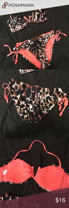 Xhilaration leopard and pink bathing suit Excellent condition. Worn once or twice. Fits 34C top and size 5/27 bottom. No stains, no flaws. Comes from smoke free, pet free home. Shipping days are Tuesday through Friday. Xhilaration Swim Bikinis