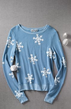 Such a cute winter pullover. Love the snowflake print.