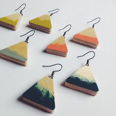 Available in 4 awesome colours! These abstract painty earrings are all one of a kind. Art for your earlobes!  Made from - Made from painted 6mm plywood, then varnished for protection. They hang from a black tone ear wire. Choose from grey, teal, mustard or coral.  Please be aware that each earring is hand painted and each one will be different, although similar to those pictured. Shape may also vary. Colour may vary from monitor to monitor. Avoid contact with water and perfume…