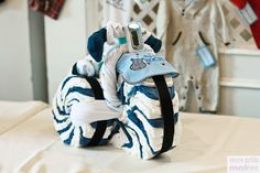 Who would ever want a diaper cake ?! If I have a boy I want a Dirtbike diaper cake! :)