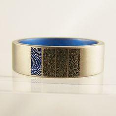 family fingerprint ring with dad's print anodised blue #jewellery #jewellerydesign #jewelleryonline #jewelleryset #jewelleryshops #bespoke #asschercut #diamond #diamondrings #style #sapphire #emerald #emeraldring #sapphirering #wedding #weddingrings