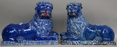 Lot 875: A rare pair of cobalt blue glazed Lunéville earthenware lions, second half 18thC, H 35,5 - W 47 - D 23,5 cm (seldom available in a pair - one with restoration)  € 3.000 - € 4.000