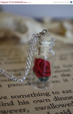 ON SALE Beauty and the Beast Rose Vial Necklace - You Choose the Color. $12.80, via Etsy.